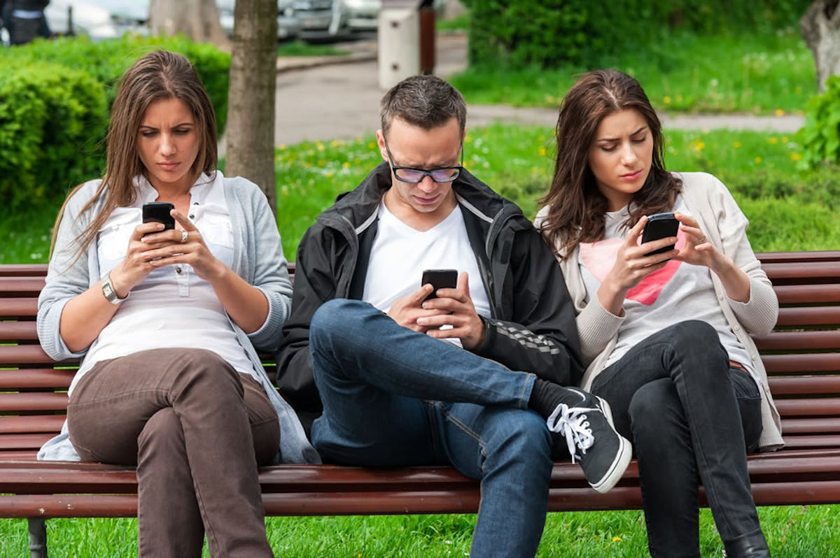Three People Looking At Push Notification Messages