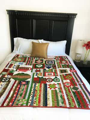 Reversible Gypsy's Wife made with Christmas prints Lap Quilt
